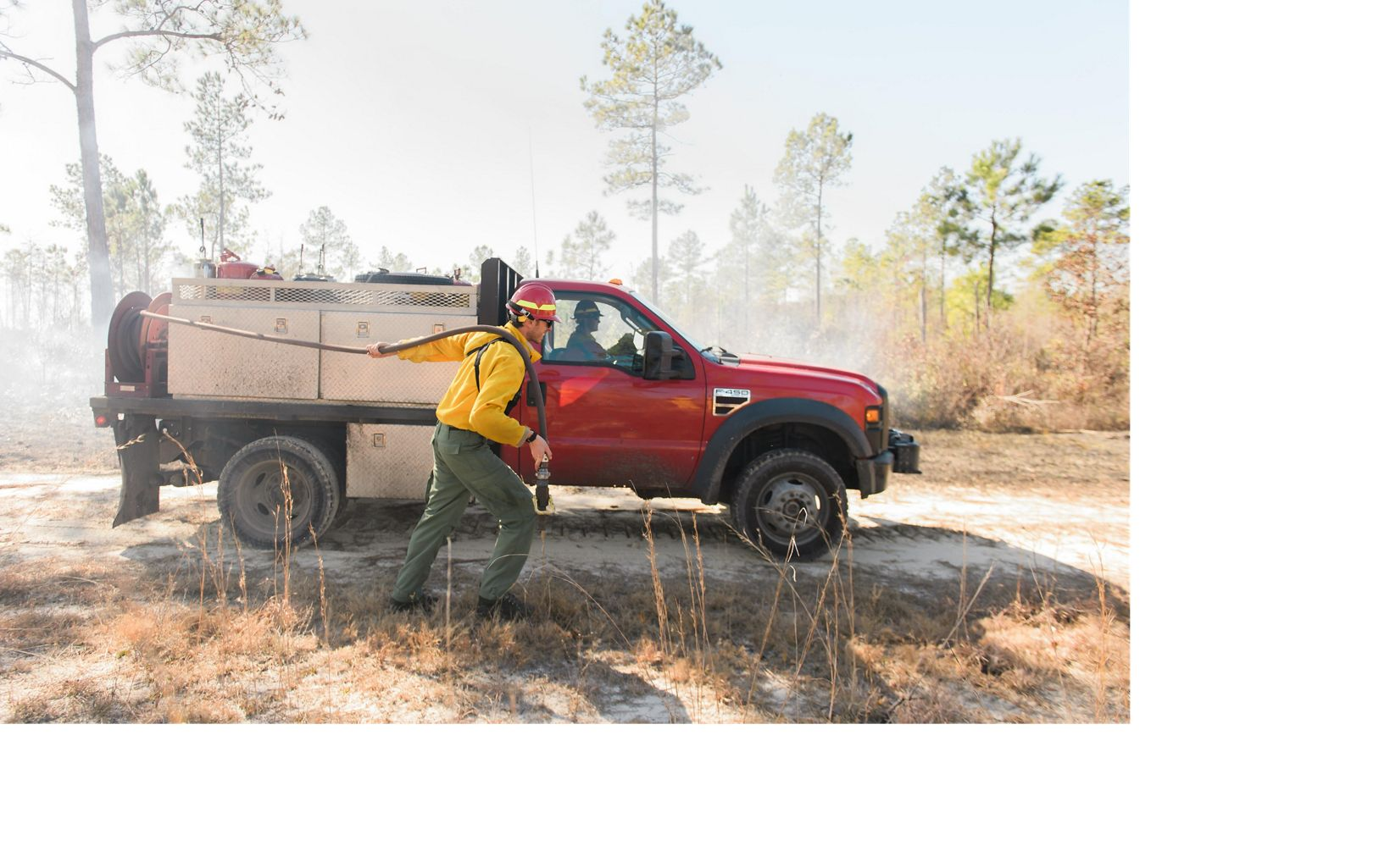 Wetting the fire lines of a controlled burn in North Carolina's Green Swamp.