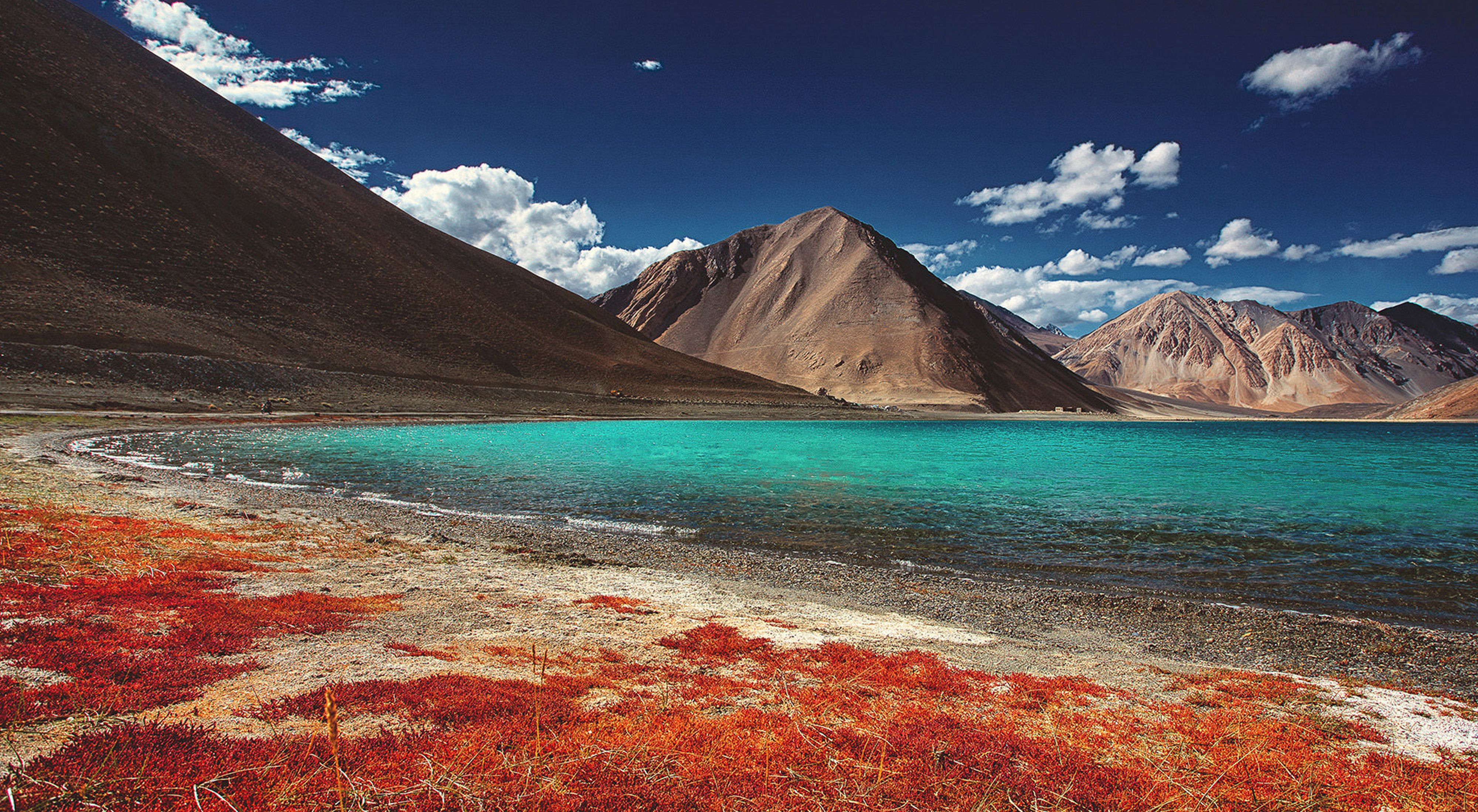 Pangong Lake, also known as Pangong Tso Lake, is situated in the Himalayan range approximately 140kms from Leh in Jammu and Kashmir, India.