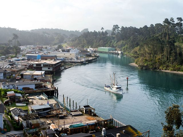 A fishing vessel leaves Noyo Harbor in Fort Bragg.