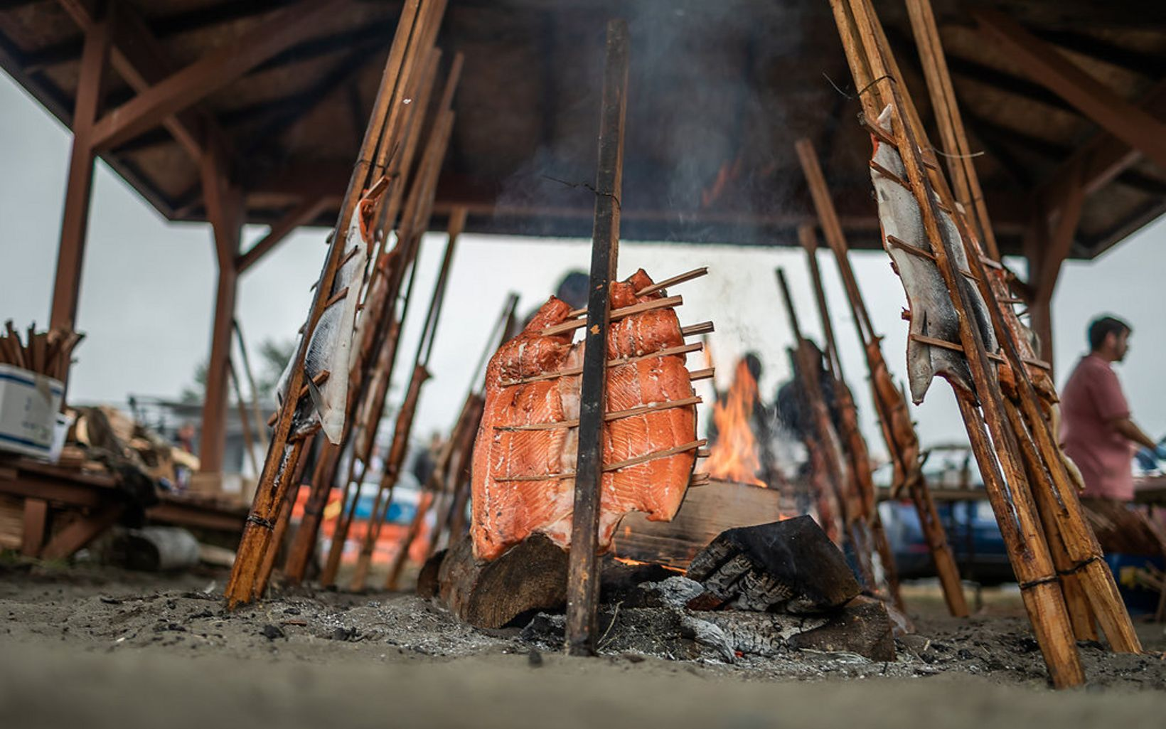 mount salmon on cedar pikes for slow smoking on the beach in Neah Bay. This ancestral method is handed down to each generation and honors the salmon for its pivotal role.