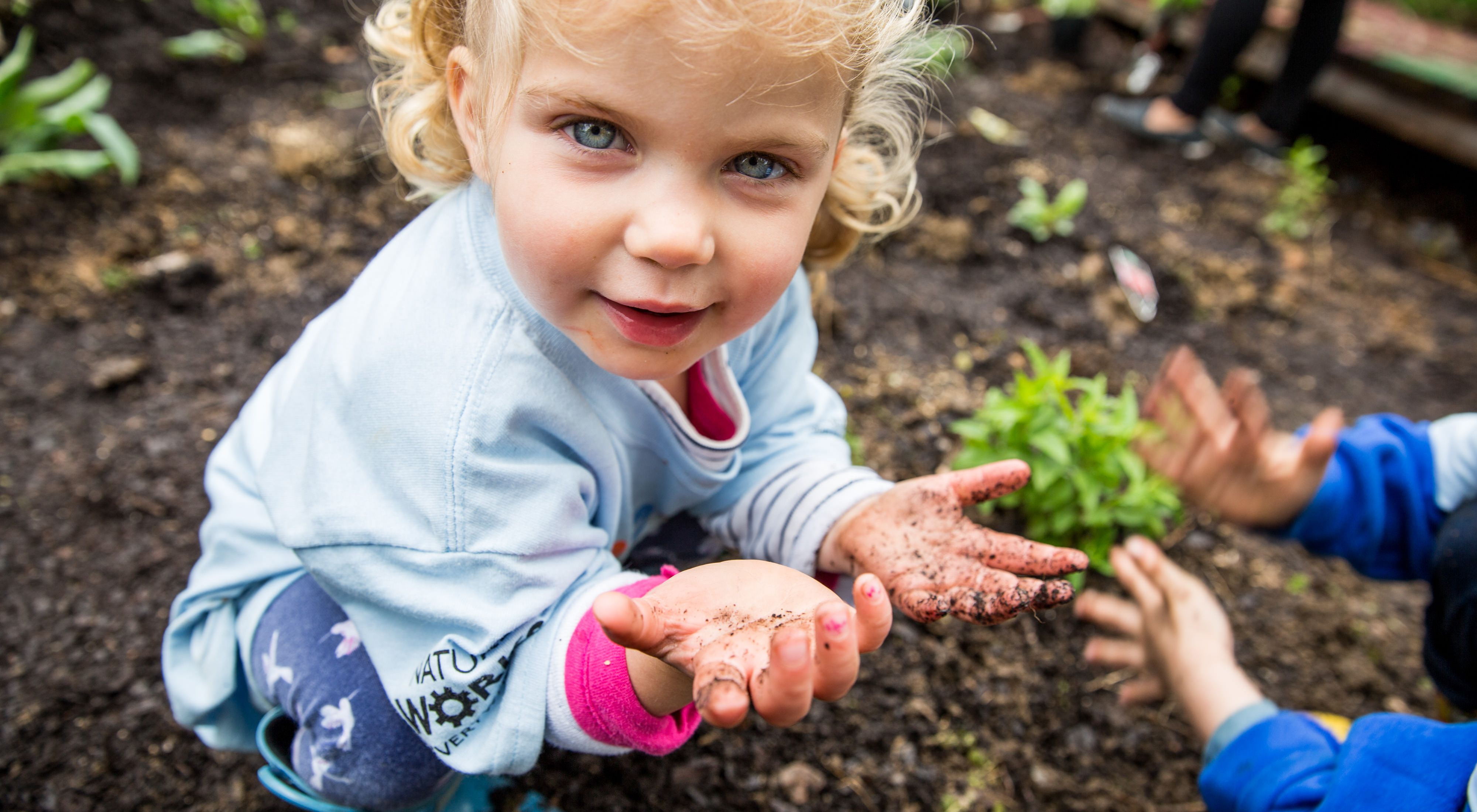 A young girl volunteers at Seaton Elementary school for a garden build day in the Shaw District of Washington, D.C.
