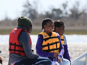 Family enjoying a boat tour at Brownsville Preserve