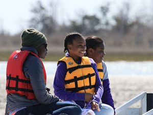 Family enjoying a boat tour at Brownsville Preserve.