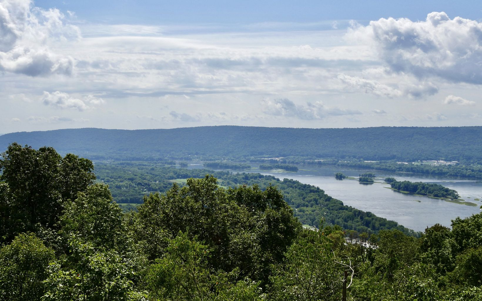 Scenic view from the Appalachian Trail. The wide, smooth Susquehanna River flows below the vantage point curving to the left towards the Cove Mountain ridge line.