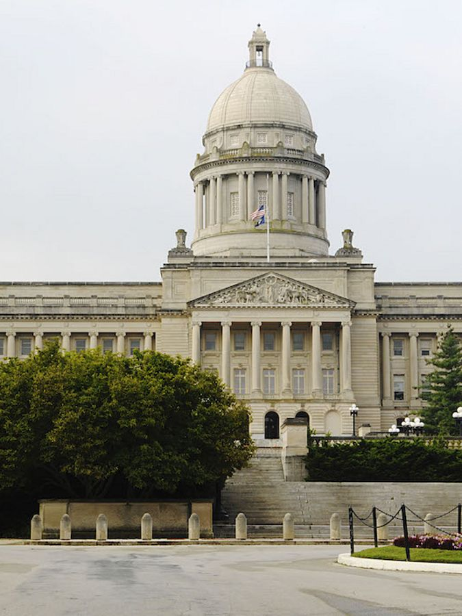 The Kentucky State capitol building with flags flying.