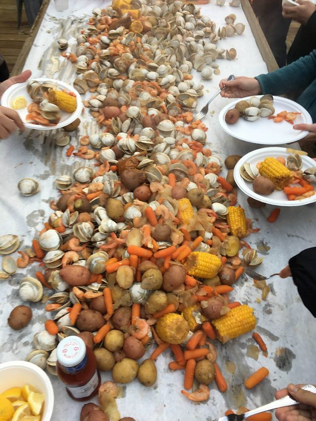 Boiled shrimp, corn and white potatoes are spread out on newspaper for an Eastern Shore feast.