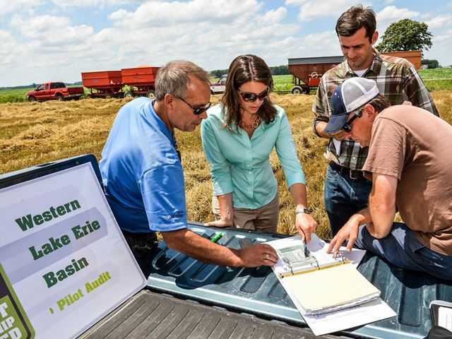 Conservancy scientist Carrie Vollmer-Sanders (second from left) works with partners in the Western Lake Erie Basin to protect water quality while maximizing crop production. Lake Erie provides drinking water to an estimated 11 million people. © Randall Schieber