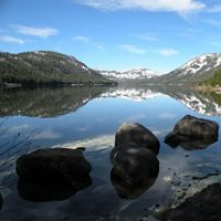 Mountains reflecting in a clear lake.