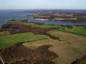 Aerial view of Chesapeake Bay with farmland beside it.