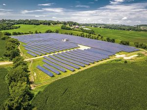 Photo of a solar energy facility between Wisconsin farm fields.