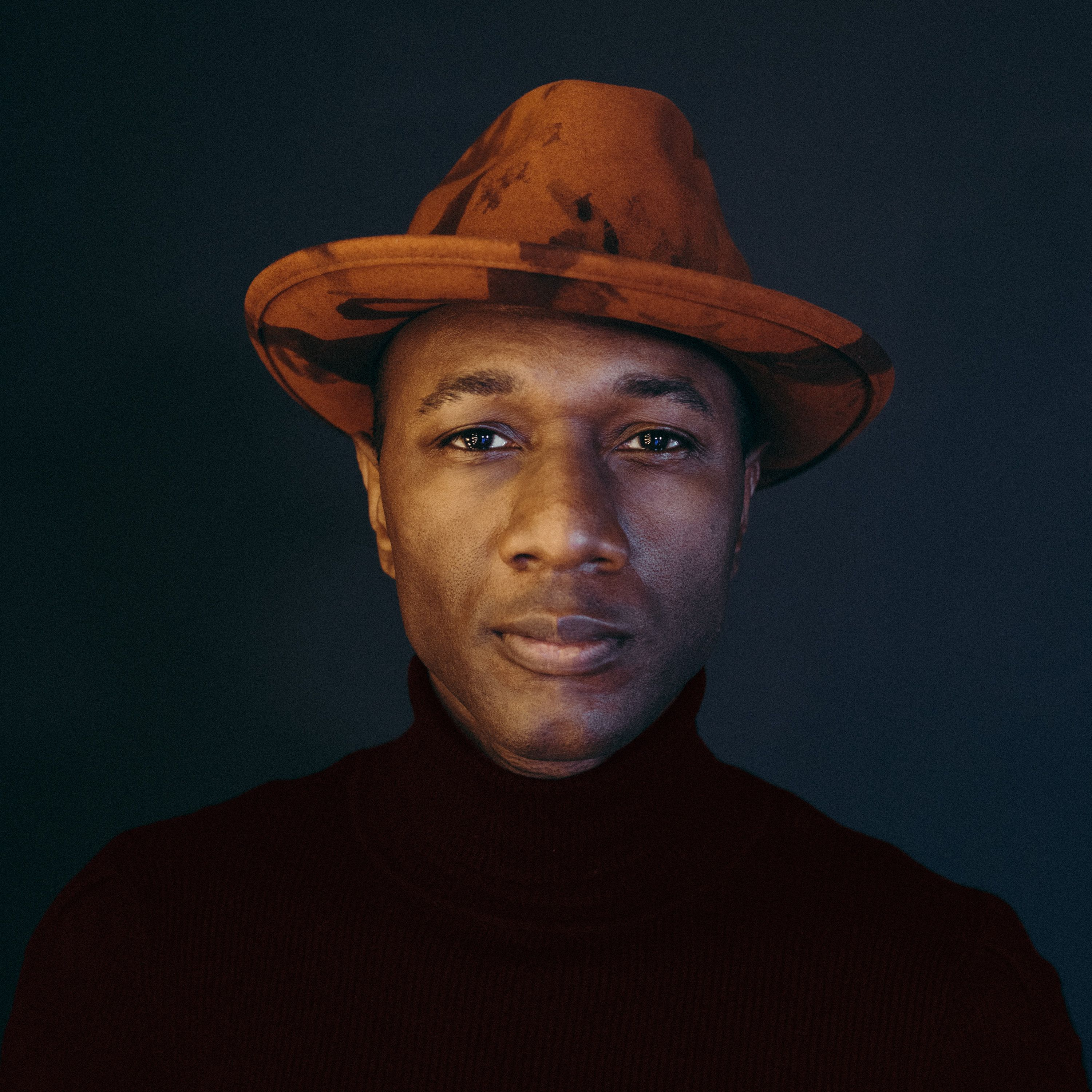 Headshot of Aloe Blacc.