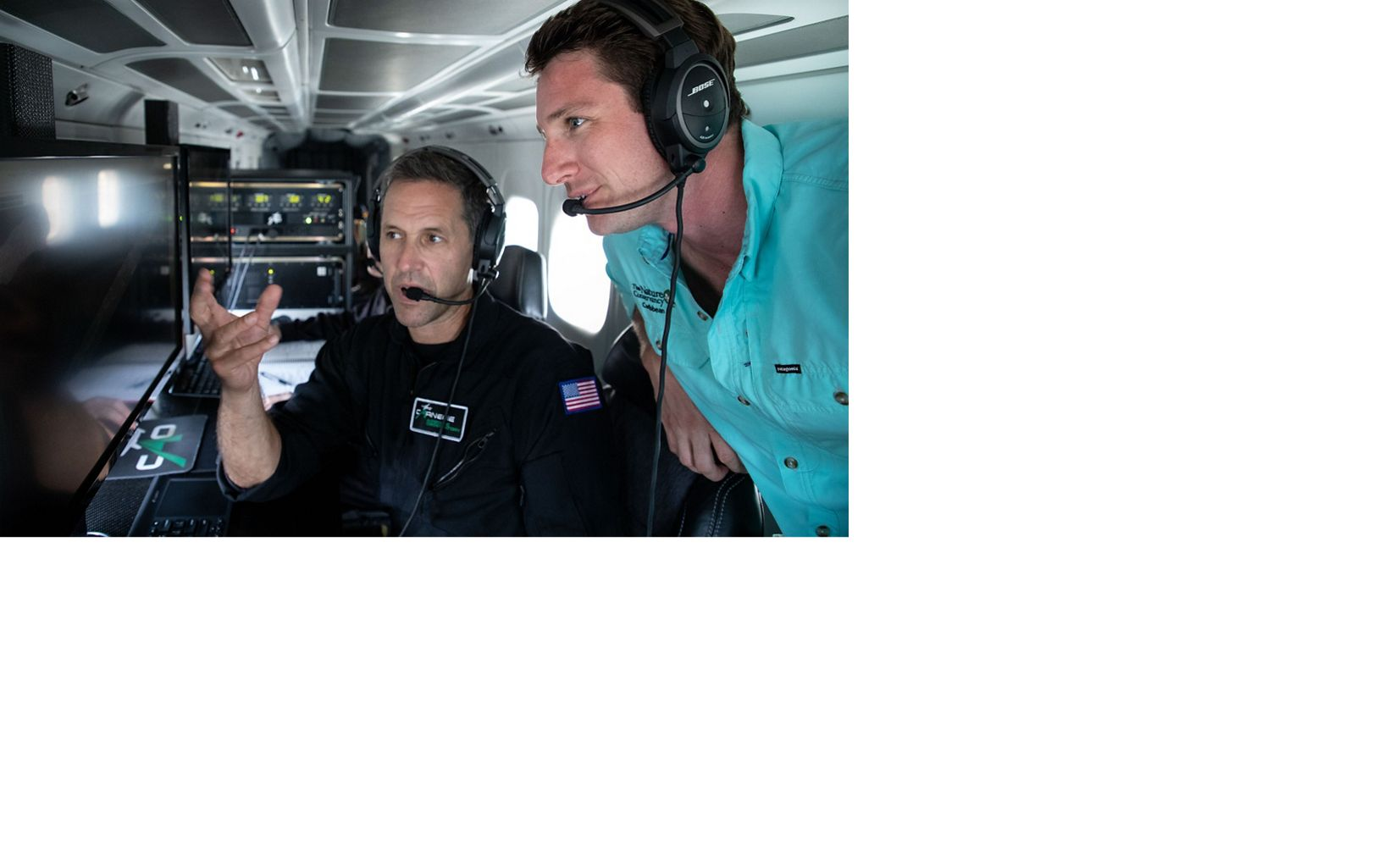 Dr. Greg Asner of the CAO and Joe Pollock, Coral Strategy Director for TNC in the Caribbean analyze data being monitored by the CAO aircraft, while on a fly over mission.