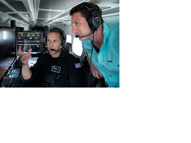 Dr. Greg Asner of the CAO and Dr. Joe Pollock, Coral Strategy Director for TNC in the Caribbean, analyze data being monitored by the CAO aircraft, while on a fly over mission.