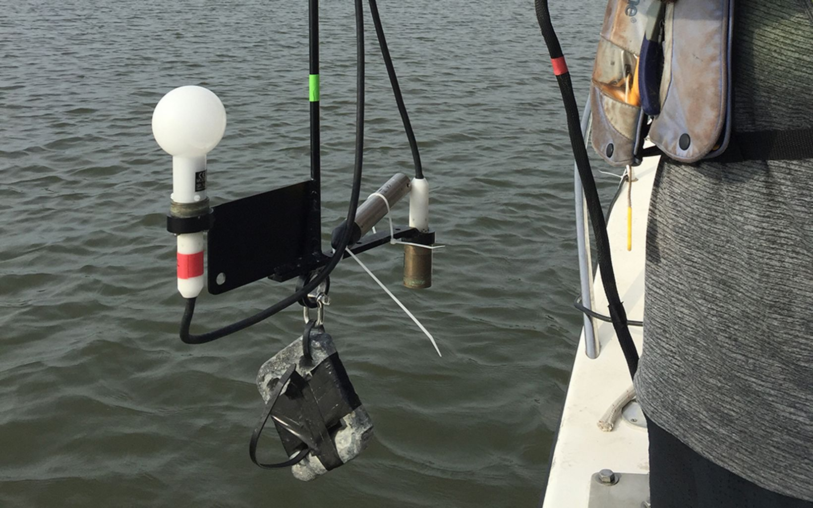 Scientists lower this sensor over the side of the boat to determine both how much light is being absorbed and how much is being scattered by particles in the water.