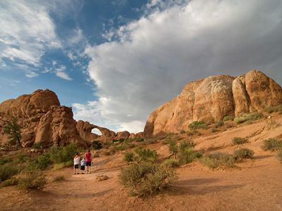 Family hiking at Arches National Park.