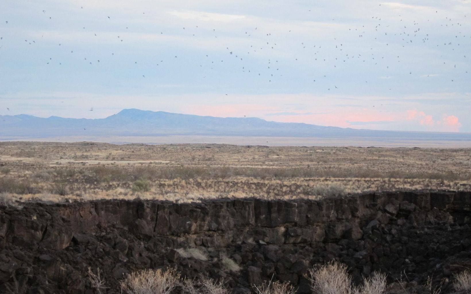 The sun sets over the Armendaris Ranch and its protected bat population.