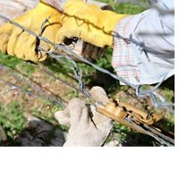 Volunteers maintain fencing at a TNC preserve in Oregon