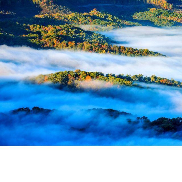 Mist rises above ridges at the Ataya tract.