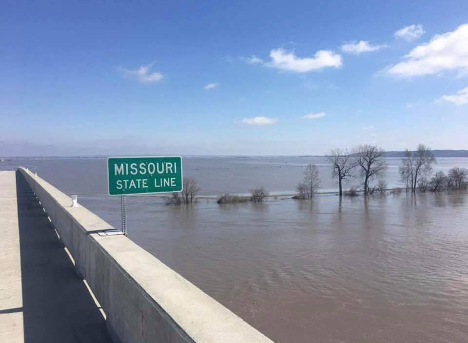 Flood waters cover land at the Missouri state line.