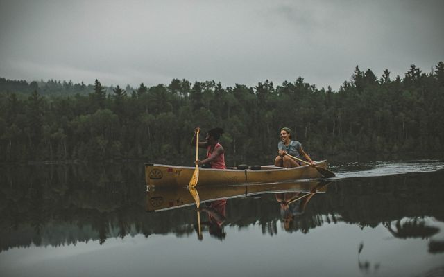 Two people paddling a canoe within the boundary waters of the Superior National Forest that provides a climate resilient landscape for wildlife and outdoor recreation.