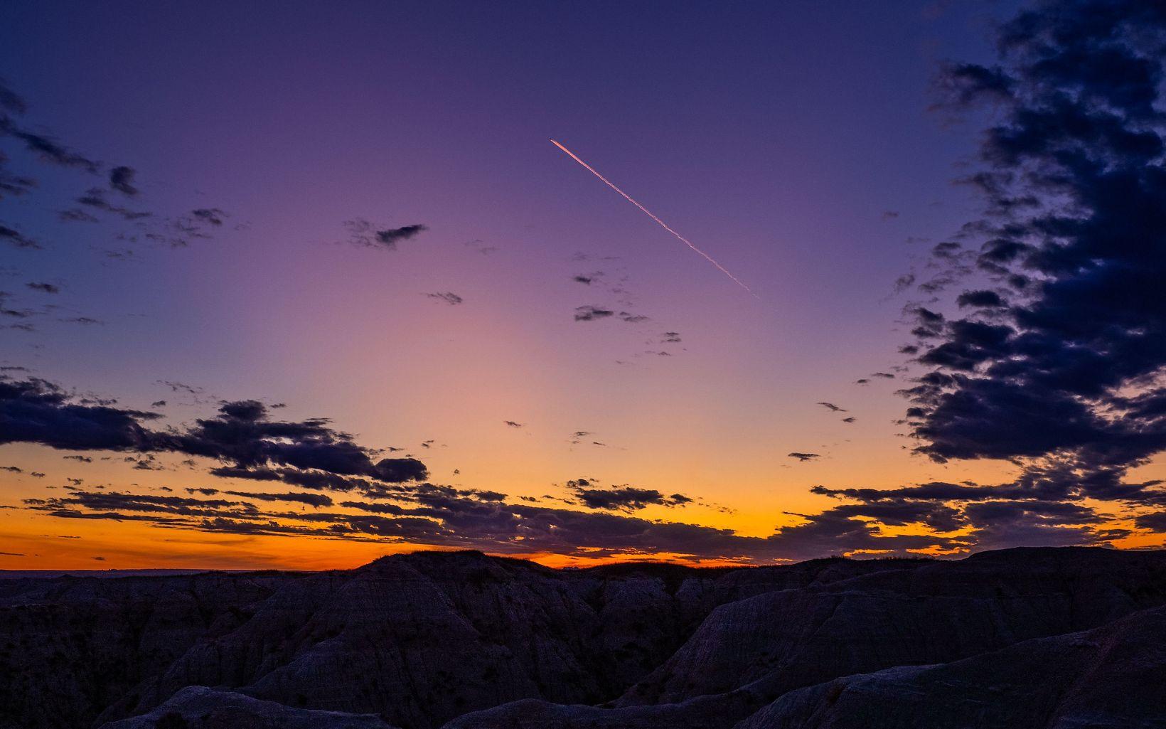 Jet Trail at sunset in Badlands National Park
