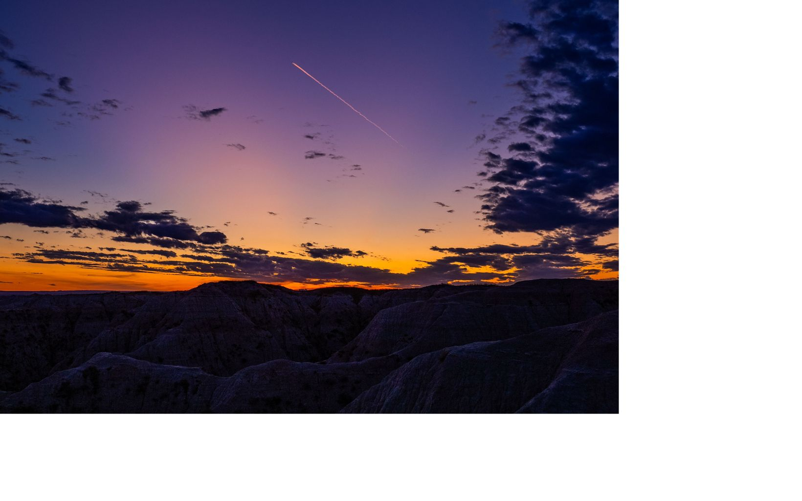 Jet Trail at sunset in Badlands National Park