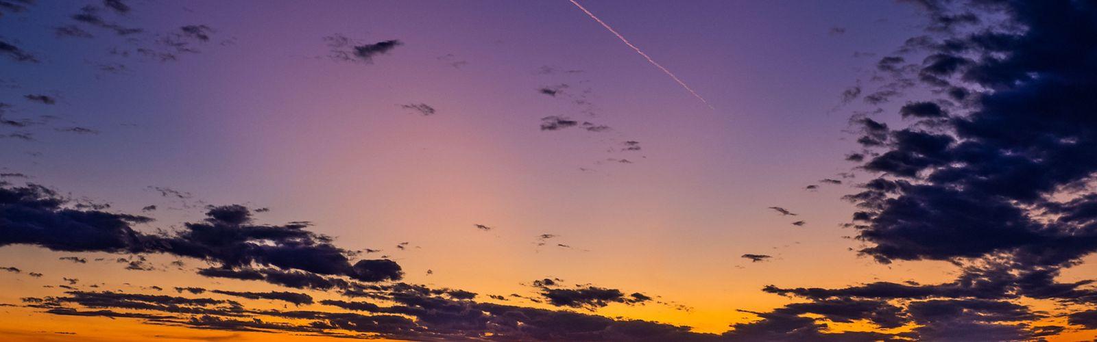Jet trail at sunset in Badlands National Park, South Dakota.