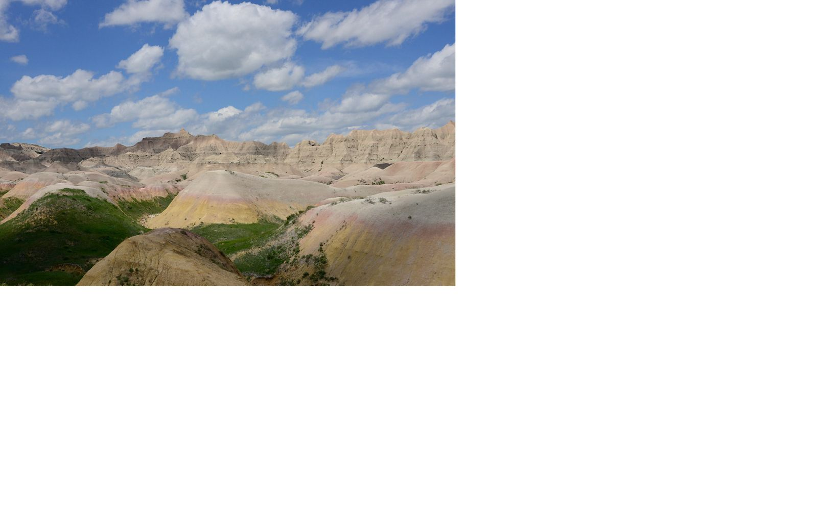 Badlands landscape and cloud shadows.