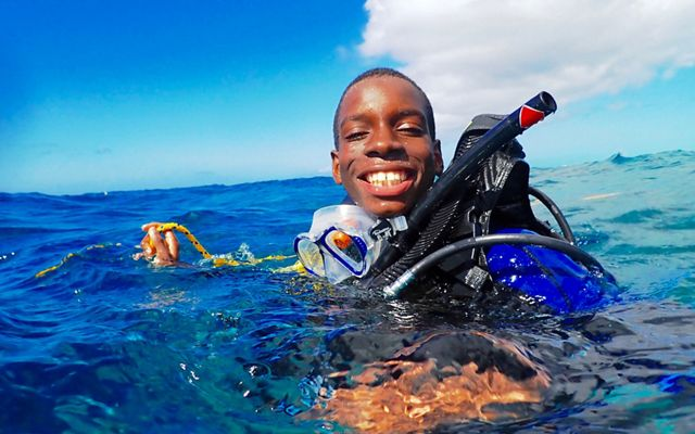 A student camper snorkels in Bahamian waters.