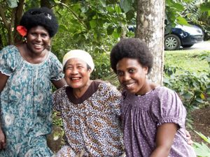 During a workshop in Palau, women visited a local taro patch to learn conservation practices. Left to right: Attendee Barbara Masike, taro patch owner, attendee Marietta Pau.