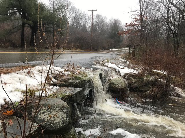 Heavy rains overwhelm the tidal culvert on Bay Road in Newmarket, NH.