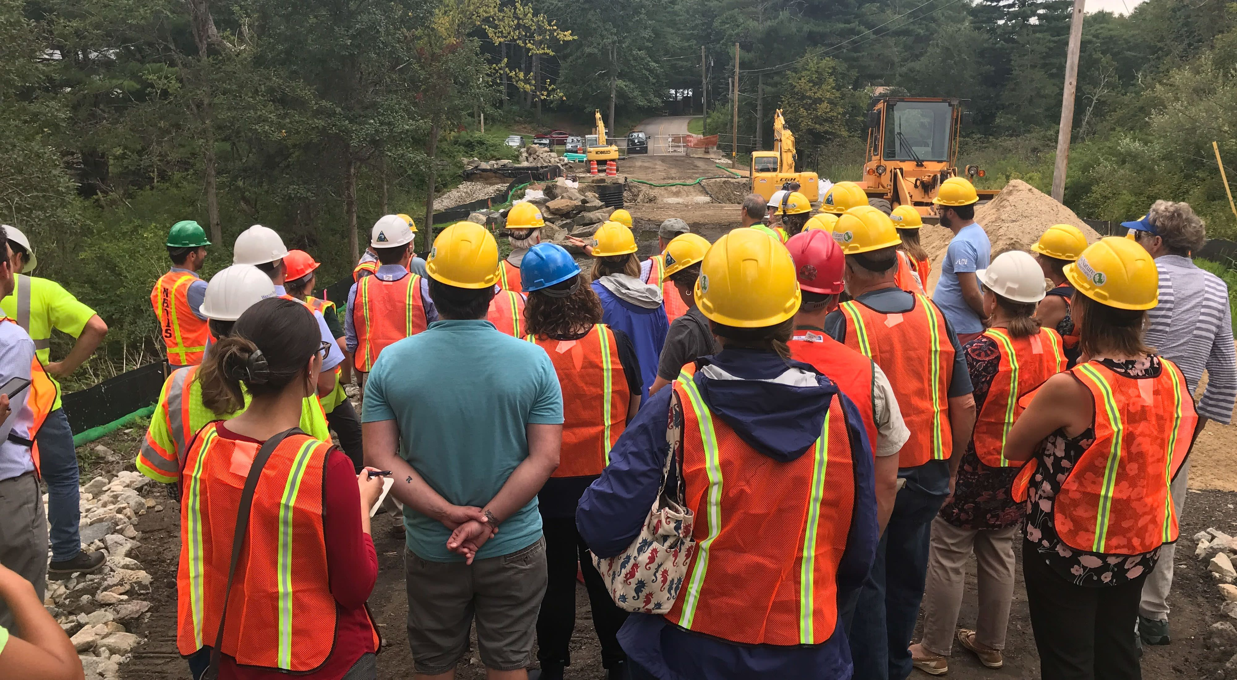 Attendees visit the site of the tidal culvert restoration on Bay Road in Newmarket, NH.