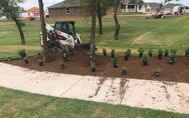 Monarch and pollinator habitat being planted in a neighborhood development next to a sidewalk.
