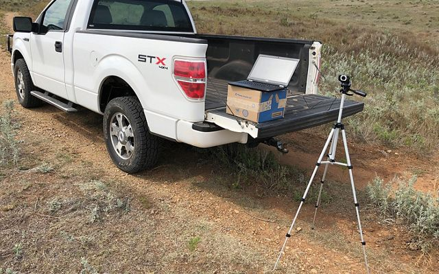 Truck bed balancing camera equipment for a Zoom webinar.