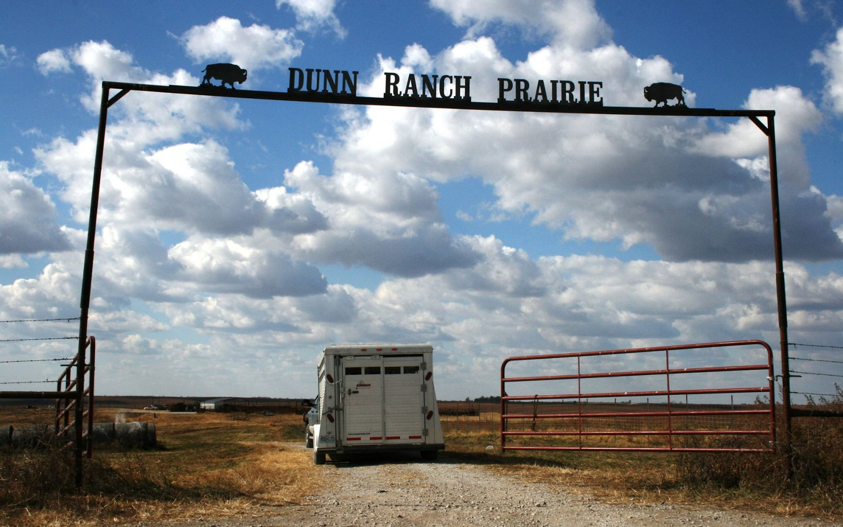 a trailer is pulled through the gates of Dunn Ranch Prairie