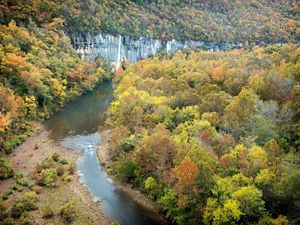 The Buffalo National River flows past rock bluffs.
