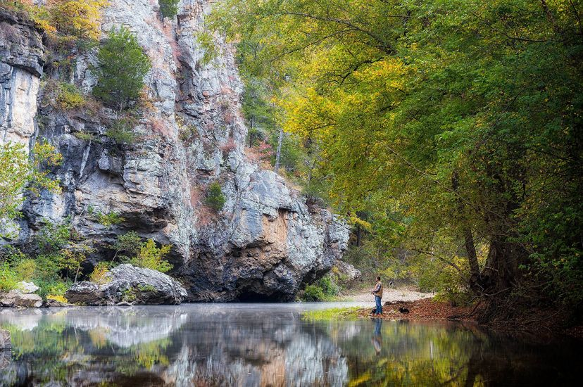 Man fishing on the shore of the Buffalo National River.