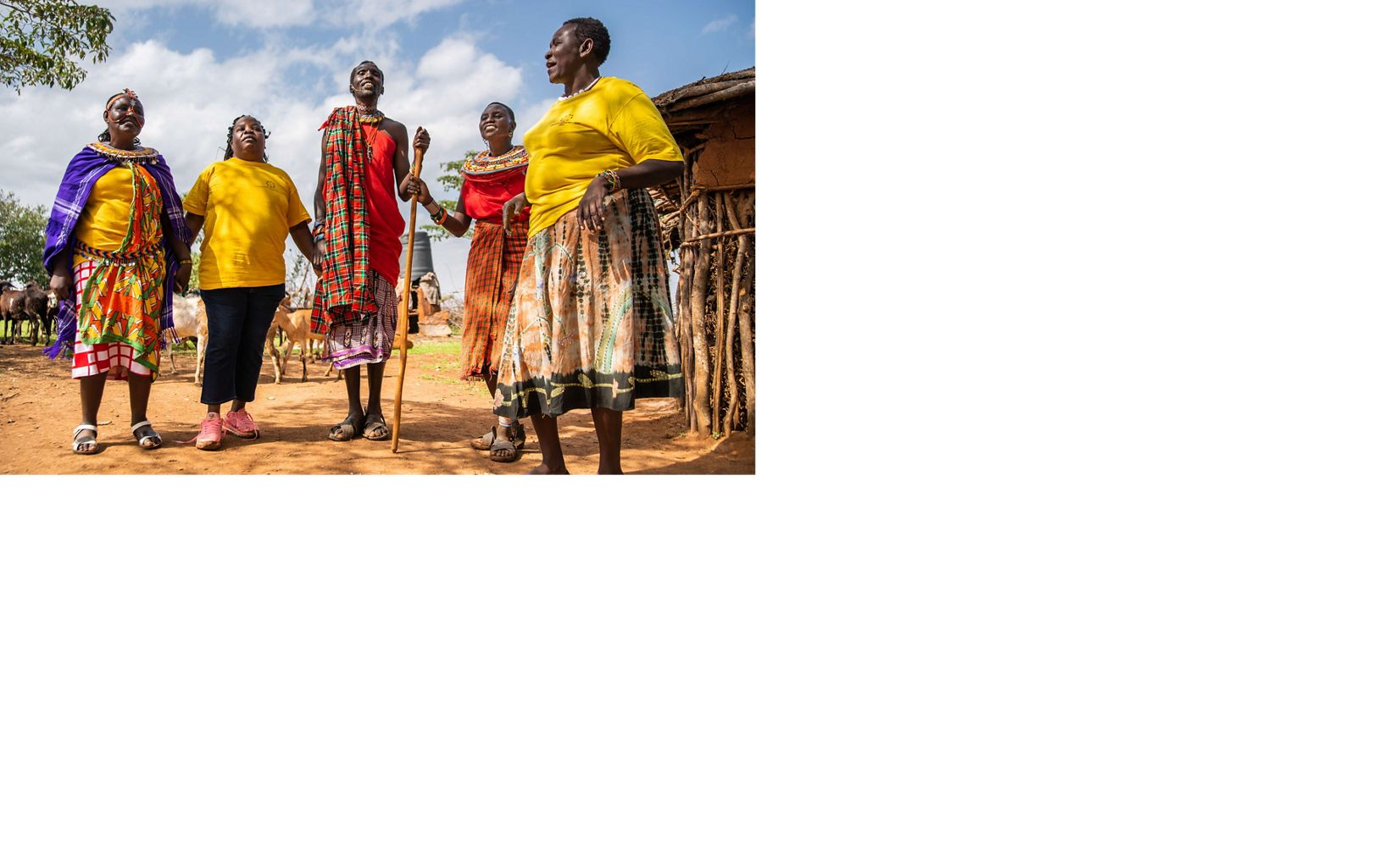 CHAT's Susan Lantare, Rose Kimanzi, and Pauline Lokipi (from left to right, in yellow) sing and dance with CHAT clients Bahati Lequto and Selina Molparakuo.