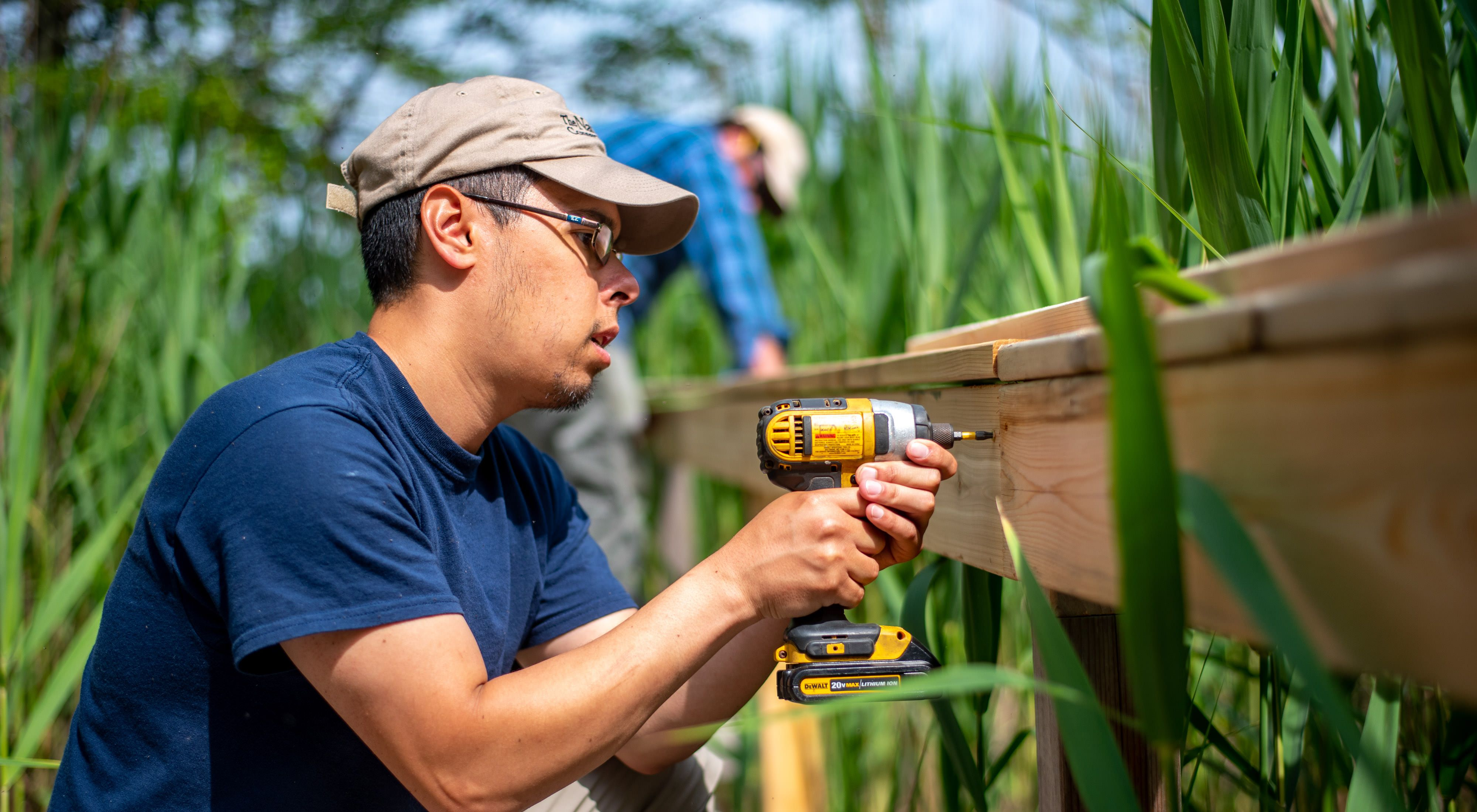 The Nature Conservancy team constructs a boardwalk at this Long Island preserve.