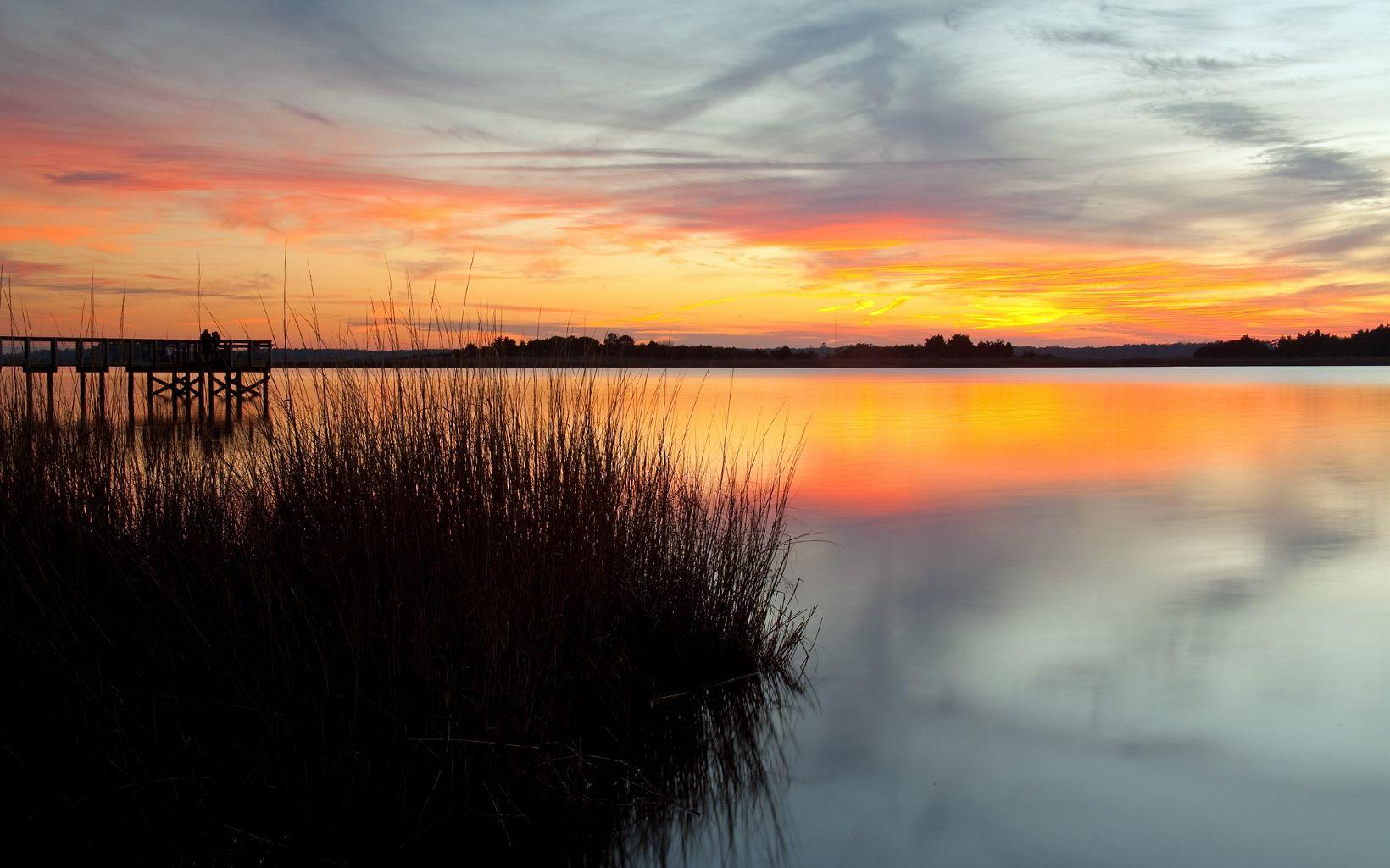 The sun setting over the Cape Fear River.