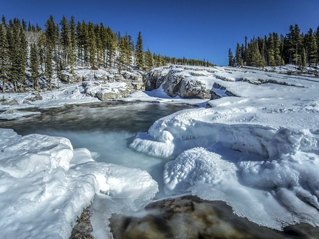 Freezing cascades at Elbow Falls in Alberta, Canada. This photo was entered into The Nature Conservancy's 2018 Photo Contest.