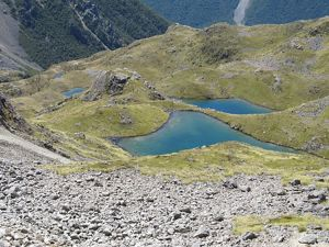 Mountainous land with small blue lakes.