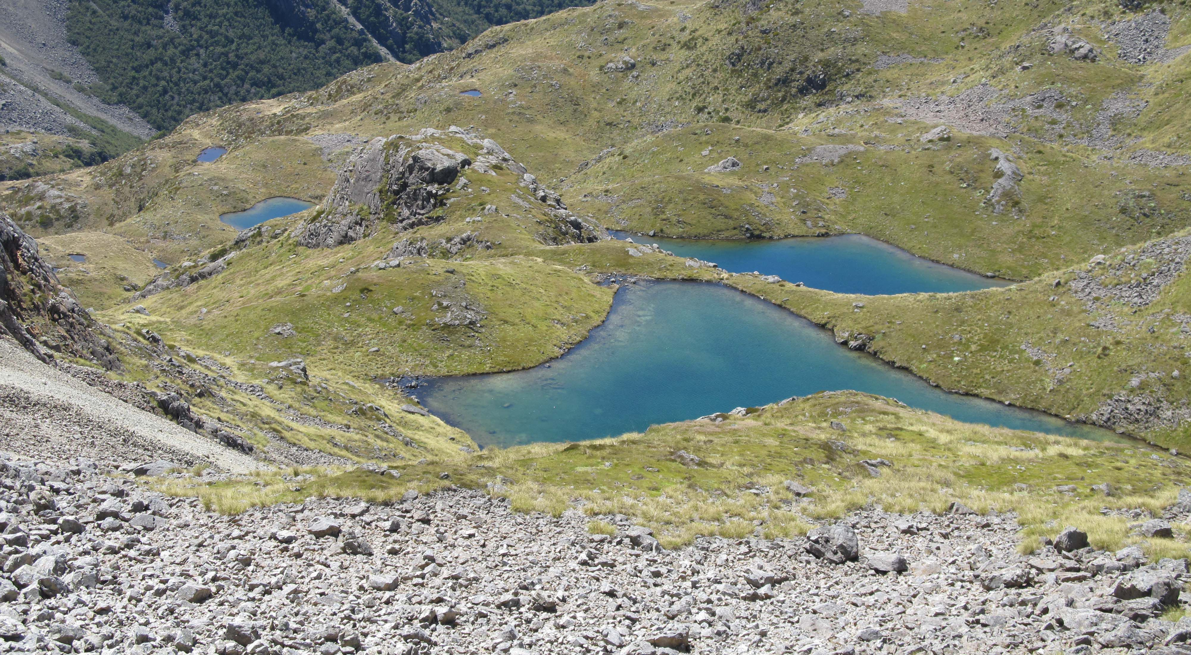 Mountains with small blue lakes in the valleys.
