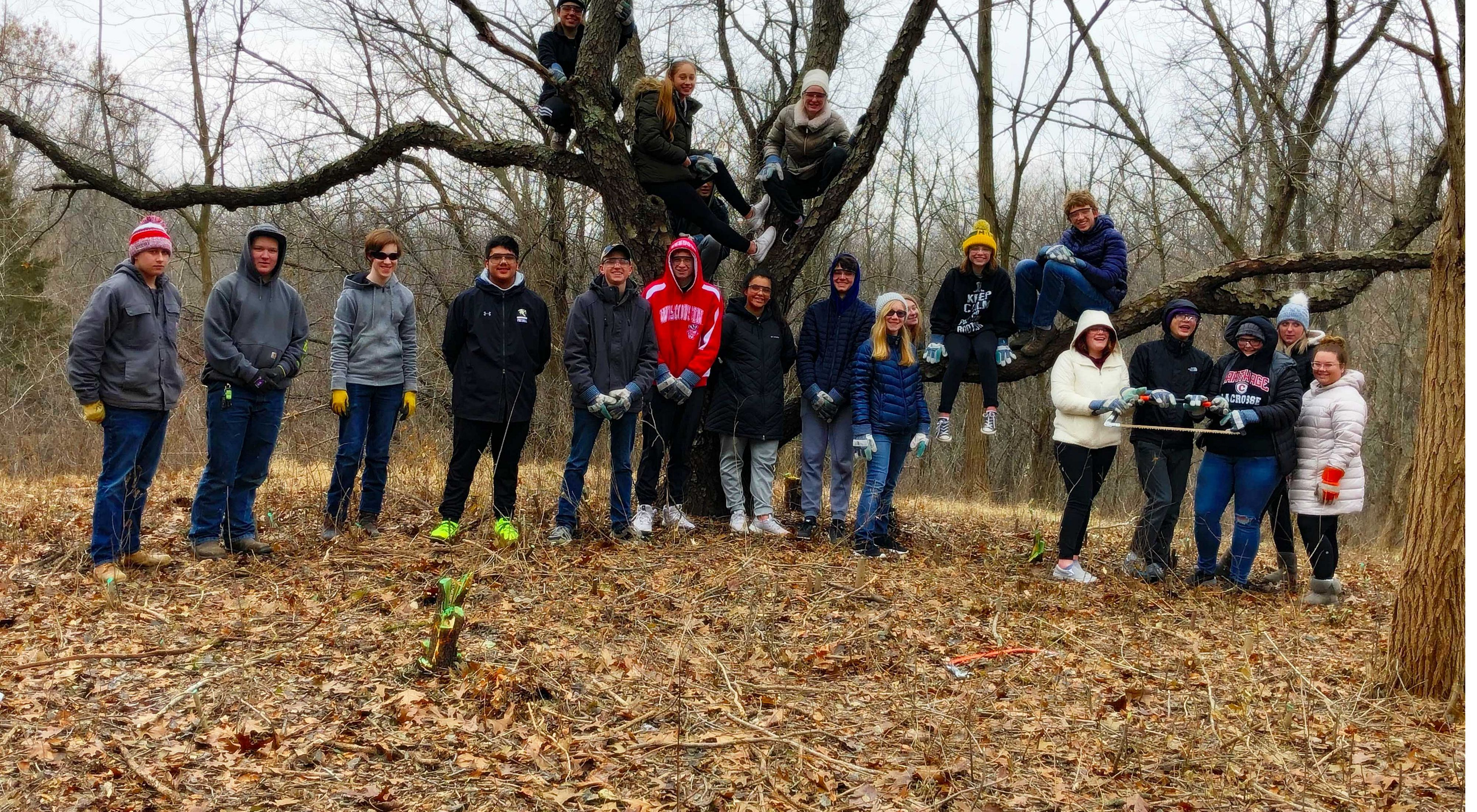 A group of high school students after removing invasive buckthorn and honeysuckle.