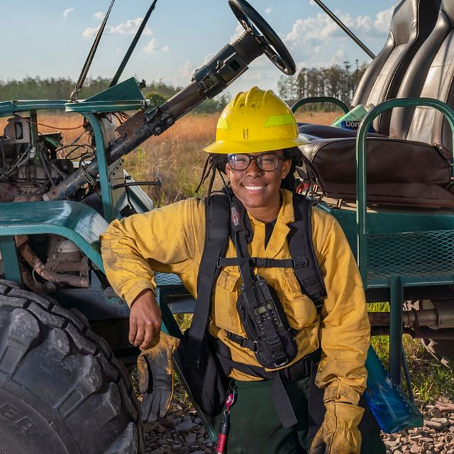 Portrait of TNC staffer Char'Reese Finney during a prescribed burn at the Disney Wilderness Preserve in Florida.