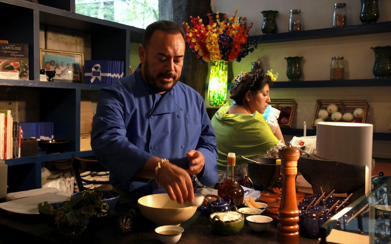 Mexican c hef Ricardo Munoz prepares a dish in his kitc