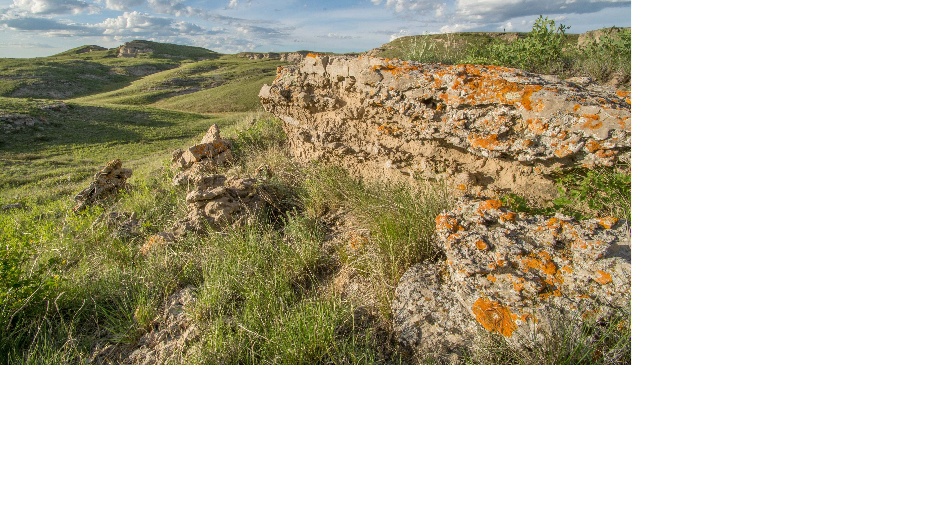 Rock escarpments in a rolling, native grassland