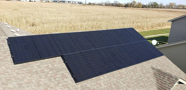 Photo of a rooftop solar installation near an Iowa farm.