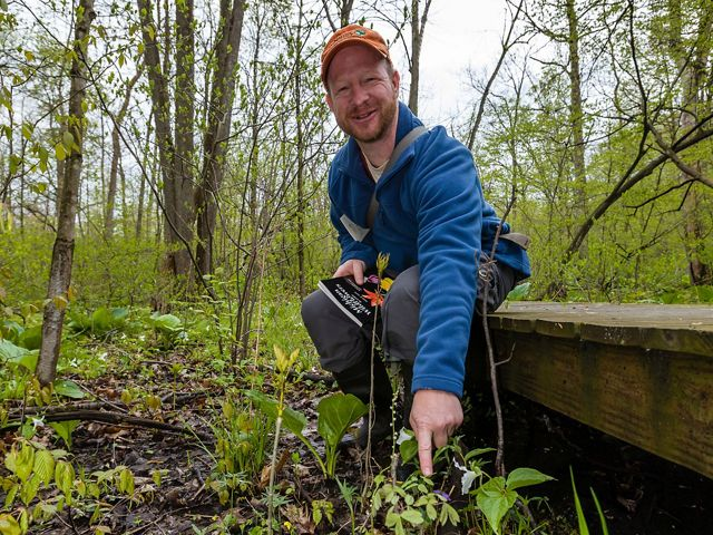 Director, Protect Land and Water, Chris May points out plants for hikers at Nan Weston Nature Preserve at Sharon Hollow.