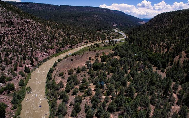Photo of a sweeping view of Rio Chama river between mountains in New Mexico.